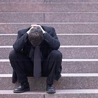 depressed-banker-fix